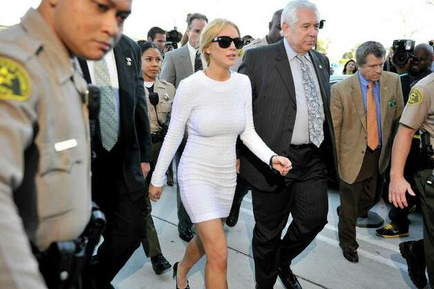 LOS ANGELES, CA - FEBRUARY 09: Lindsay Lohan (4th L) arrrives for her arraingment at the Airport Courthouse on February 9, 2011 in Los Angeles, California.  Lohan was charged with a felony count of grand theft for allegedly stealing a $2,500 necklace from a jewelry store in Venice, California.  (Photo by Toby Canham/Getty Images) Photo: Toby Canham