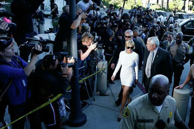 LOS ANGELES, CA - FEBRUARY 9:  Actress Lindsay Lohan arrives to court for an arraignment hearing in connection with the alleged theft of a $2,500 necklace on February 9, 2011 in Los Angeles, California. Lohan has been charged with a felony count of grand theft for allegedly walking out of a Venice, California store with the necklace in January.  (Photo by David McNew/Getty Images) Photo: David McNew