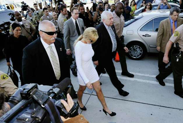 LOS ANGELES, CA - FEBRUARY 09:  Actress Lindsay Lohan arrives for her arraignment for a felony count of grand theft on February 9, 2011 in Los Angeles, California. Lohan was charged with a felony count of grand theft for allegedly stealing a $2,500 necklace from a jewelry store in Venice.  (Photo by Kevork Djansezian/Getty Images) Photo: Kevork Djansezian