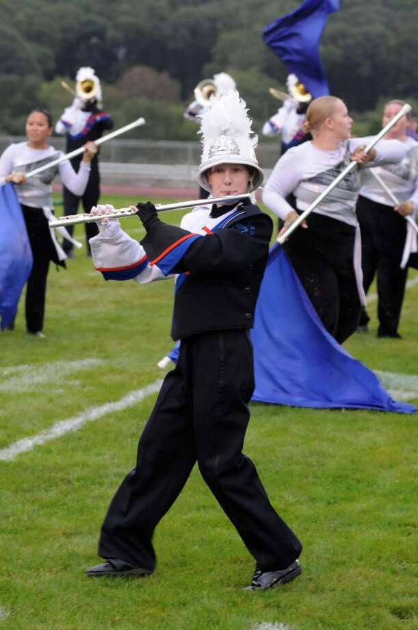 "The Danbury High School Mad Hatter's Marching Band performs at the Bethel High School Wildcat  Marching Band and Color Guard band competition ""The Quest for the Best"" on Friday evening Sept. 12, 2009. One of the bands flute players, Sheila Kennedy, stays focused on the performance. Photo: Lisa Weir / The News-Times"