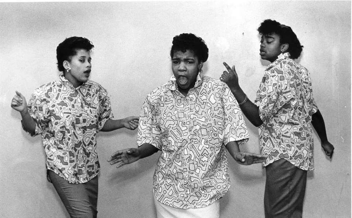 """Feb. 14, 1986: Practicing before the Talent Show at the Yerwood Center are members of the singing group """"Three in One"""" From left are Toya Hammond, Sherry Taylor and Deedee Bunch all of Stamford."""