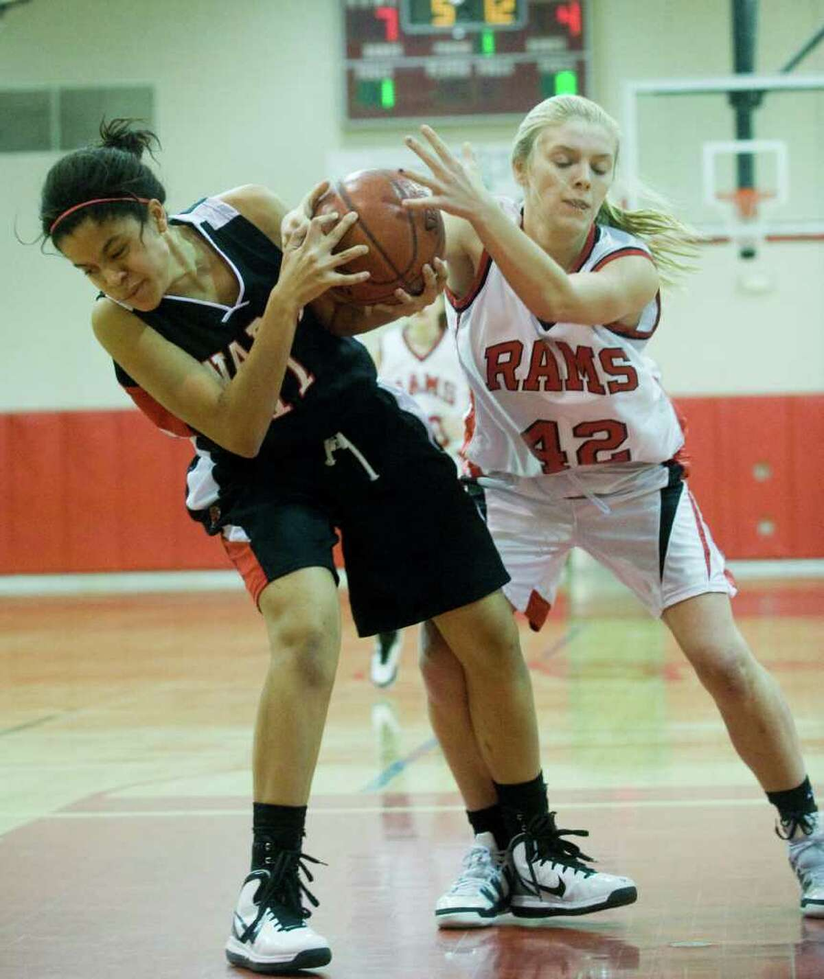 New Canaan's Kelly Armstrong and Warde's Jerelyn Luther battle as New Canaan hosts Fairfield Warde in a girls basketball game in New Canaan, Conn., February 10, 2011.