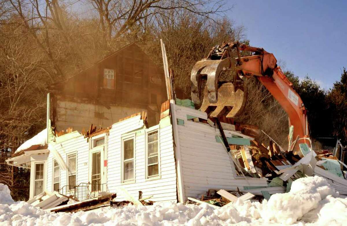 The Beardsley Farmhouse in Newtown, at 121 Wasserman Way, is demolished on Thursday, Feb. 10, 2011.