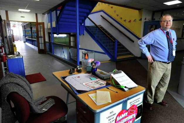 Jerry Steele, Maplewood Elementary School principal of 20 years stands at the school's front foyer in Colonie. The North Colonie school district is considering closing this school due to budget constraints. (Michael P. Farrell/Times Union ) Photo: Michael P. Farrell