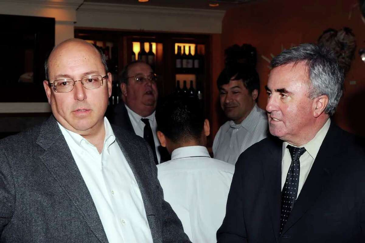 Greenwich defense attorney Philip Russell, left, speaks with lawyer and Greenwich native Mickey Sherman who will be sent to prison next month for failing to pay his taxes, at the Greenwich Tavern during a cocktail reception held for Sherman, early Thursday night, Feb. 10, 2011.