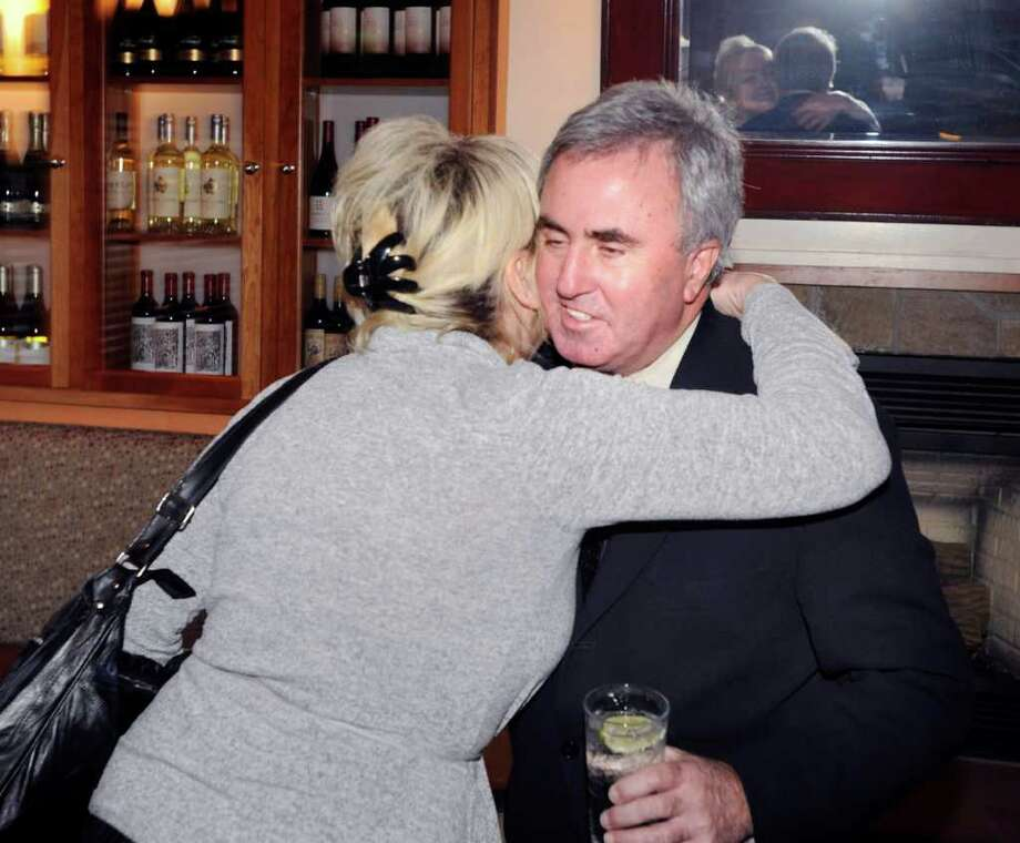 Lawyer and Greenwich native Mickey Sherman, who will be sent to prison next month for failing to pay his taxes, gets a hug from his assistant, Luisa Carella of Cos Cob, during a cocktail reception for Sherman at the Greenwich Tavern early Thursday night, Feb. 10, 2011. Photo: Bob Luckey / Greenwich Time