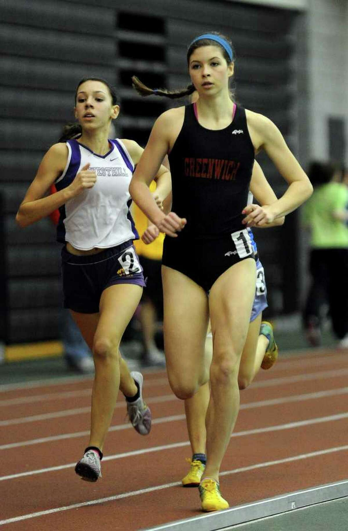 Greenwich's Kiki Kates competes in the 1000 meter run, during FICAC track championship action in New Haven, Conn. on Thursday February 3, 2011.