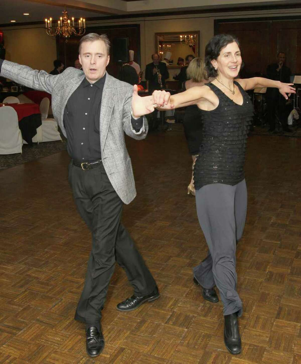 Bill and Suzanne Baetz work the dance floor. (Joe Putrock / Special to the Times Union)