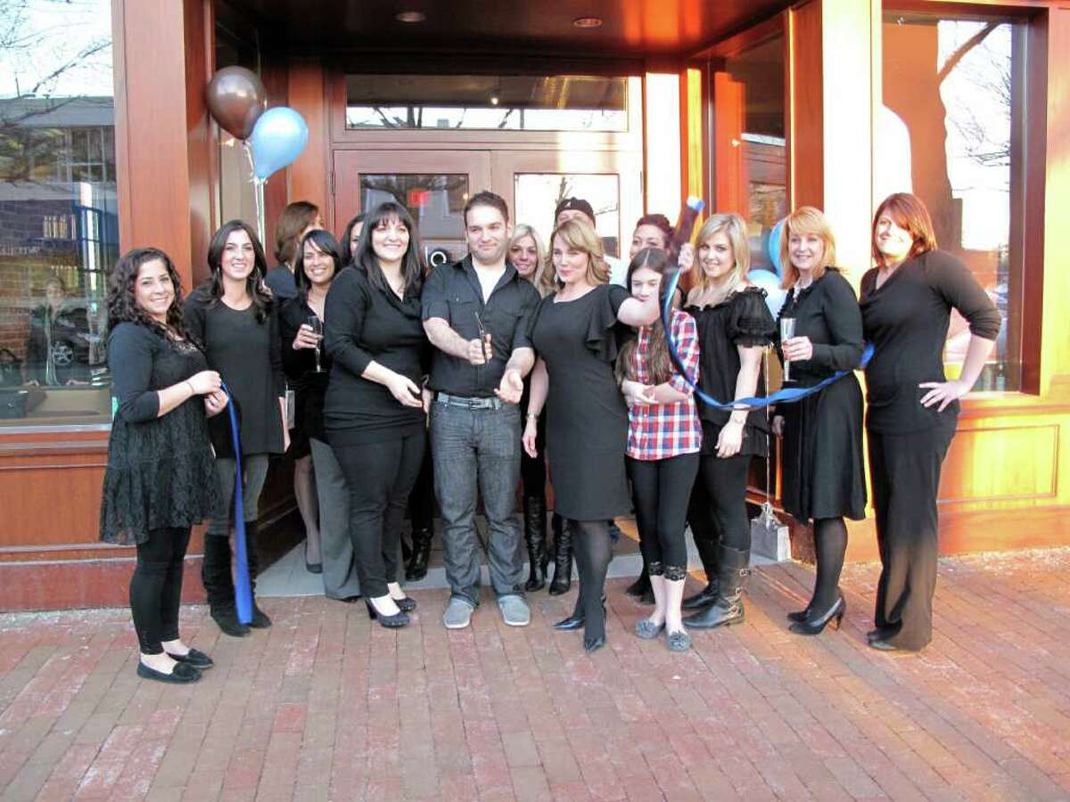 With the ribbon cut, Salon Kiklo commemorates their opening.
