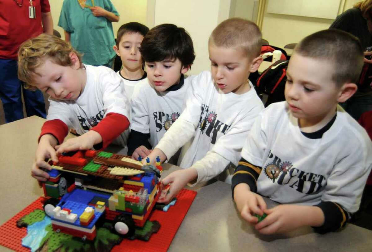Five New Milford first-graders in the Robotics Club call themselves the The Sprocket Squad. For a project on something that helps the body, the group has created a mobile hospital out of Legos. The project idea was something that helps the body. From left, Liam Cahalan,6, Ryan Sarbello, 7, Jackie Colangelo, 6, Matt Crookshank, 6, and Joey LaCava, 6. Pictured here at New Milford hospital on Thursday Feb. 10, 2010.