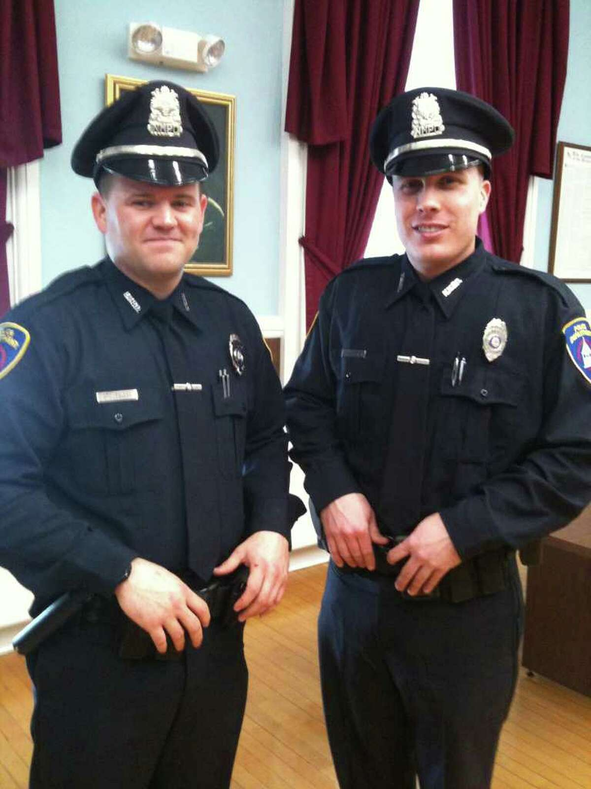 Brian Peloso, left, and David Petersen were sworn in as New Milford Police officers.