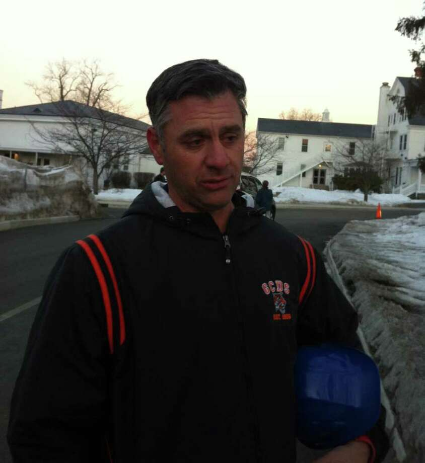 Greenwich Country Day School Headmaster Adam Rohdie at the school Friday evening, discussing a propane tank explosion and and fire that broke out in an under-construction performing arts center. Photo: Frank MacEachern, Neil MacEachern / Greenwich Time