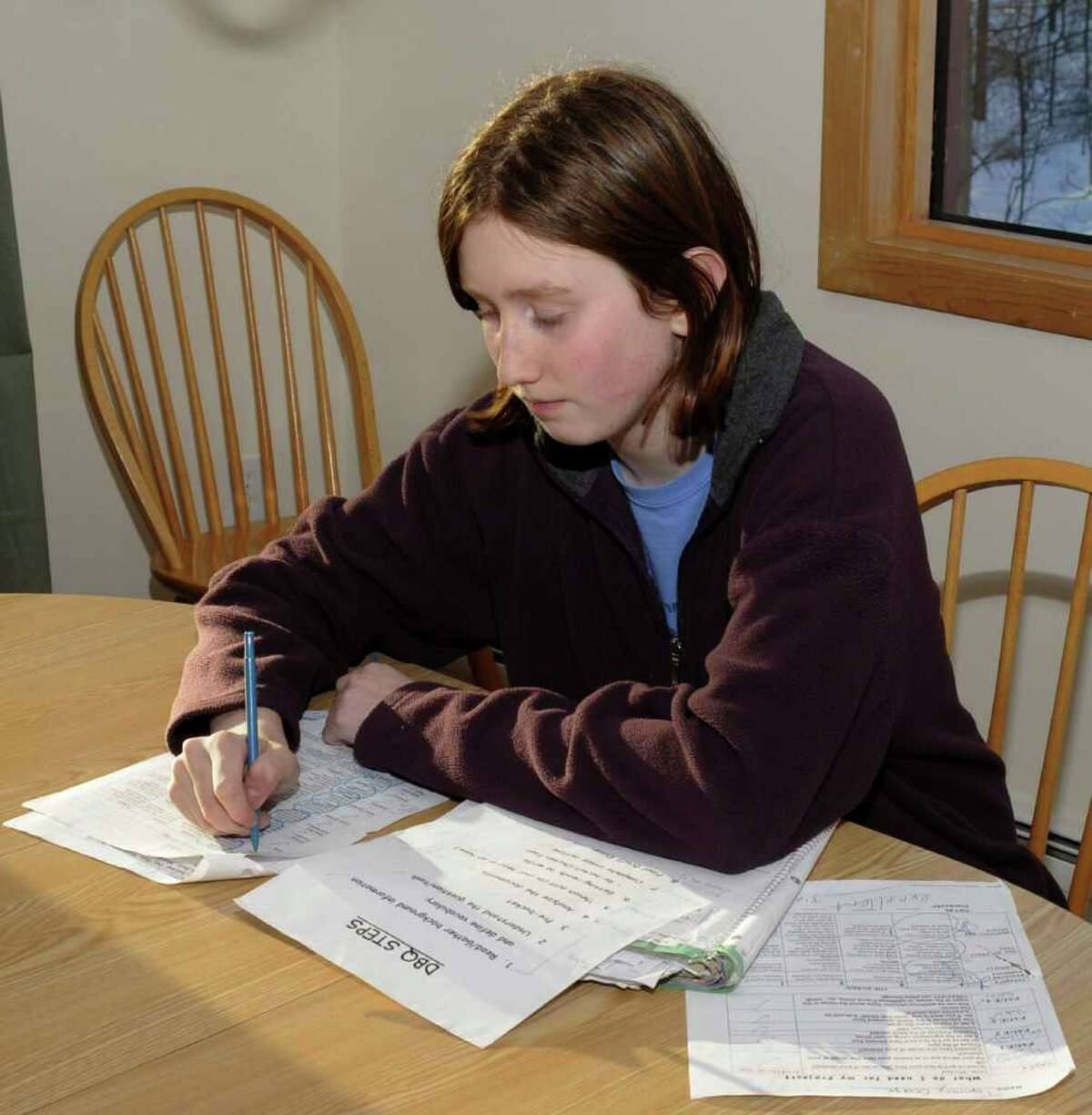Thirteen year old, Tommy George, an 8th grader at Broadview Middle School, in Danbury, uses an assignment notebook and a detailed checking system, for school projects and exams, to help maintaine his straight A grades, on Thursday, Feb 10, 2011.