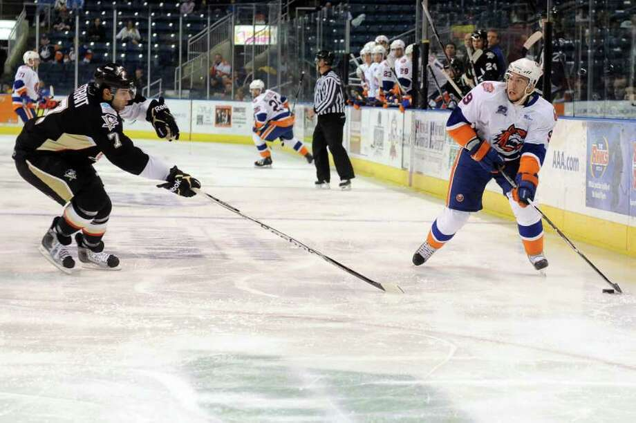 The Sound Tigers' Justin DiBenedetto takes the puck past Wilkes-Barre/Scranton Penguins' Brian Strait during Friday's game at Webster Bank Arena at Harbor Yard on February 11, 2011. Photo: Lindsay Niegelberg / Connecticut Post