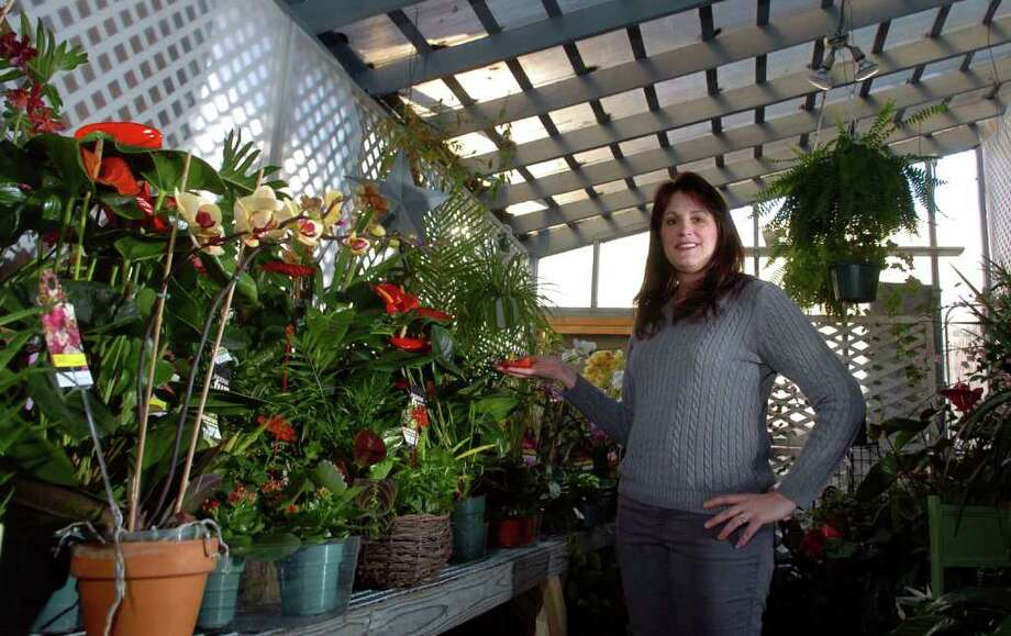 Lise Fede, owner of Fruits and Flowers, poses in the display greenhouse inside of her shop along Capitol Avenue in Bridgeport, Conn. on Tuesday February 10, 2011. Photo: Christian Abraham / Connecticut Post