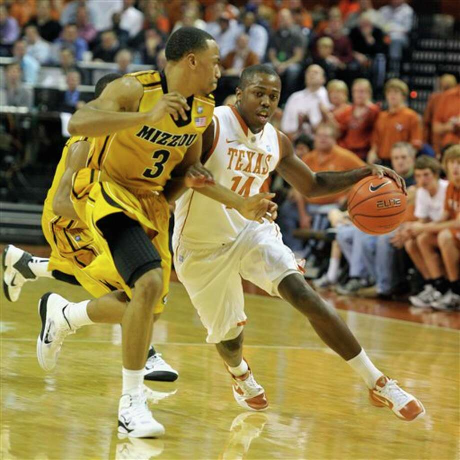 J'Covan Brown (right) has averaged 9.0 points this season as UT's sixth man. (Michael Thomas/Associated Press)