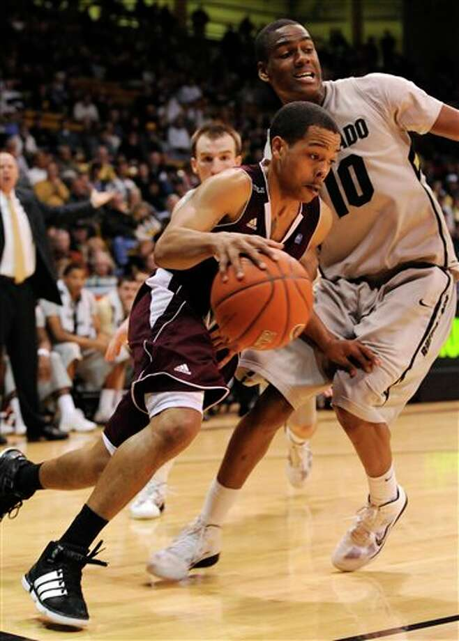 Texas A&M guard B.J. Holmes (left) drives against Colorado's Alec Burks during Wednesday's 73-70 overtime win. (JACK DEMPSEY/ASSOCIATED PRESS)