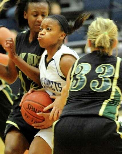 Hardin-Jefferson's Mya Williams pushes through the East Chambers defense at Hardin-Jefferson High Sc