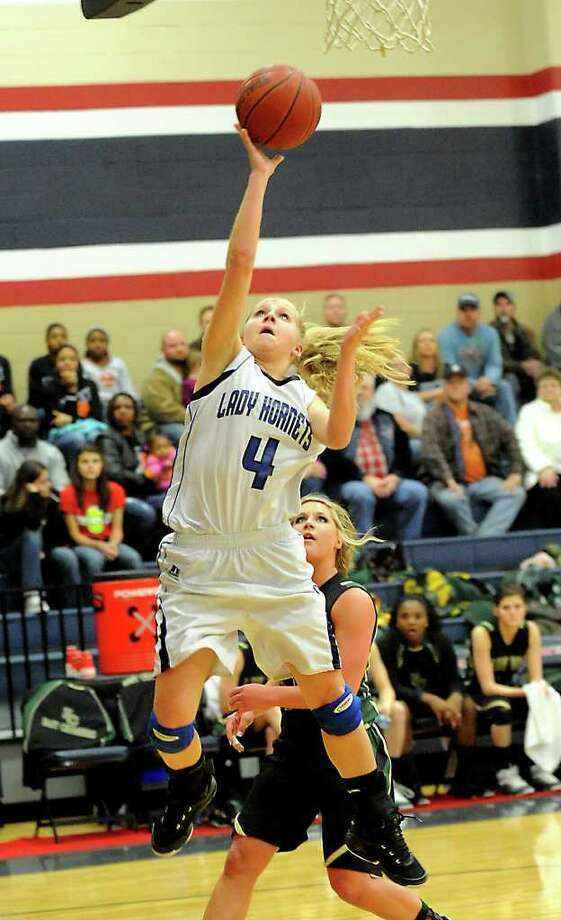 Hardin Jefferson's Stephanie Barker goes up for two points against East Chambers at Hardin-Jefferson High School in Sour Lake, Friday. Tammy McKinley/The Enterprise Photo: TAMMY MCKINLEY / Beaumont
