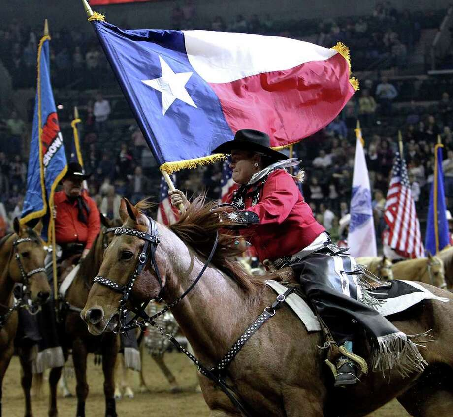 The Texas flag is presented at the opening ceremonies of the 2011 San Antonio Stock Show & Rodeo at the AT&T Center on Friday, Feb. 11, 2011. Kin Man Hui/kmhui@express-news.net Photo: KIN MAN HUI, SAN ANTONIO EXPRESS-NEWS / kmhui@express-news.net