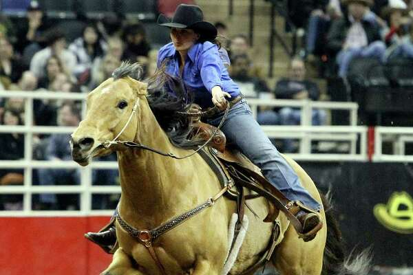 Savanah Reeves of Cross Plains, Texas competes in the barrel racing competition at the 2011 San Antonio Stock Show & Rodeo at the AT&T Center on Friday, Feb. 11, 2011. Reeves' husband, Matt, also participates in rodeos by competing in steer wrestling. Kin Man Hui/kmhui@express-news.net