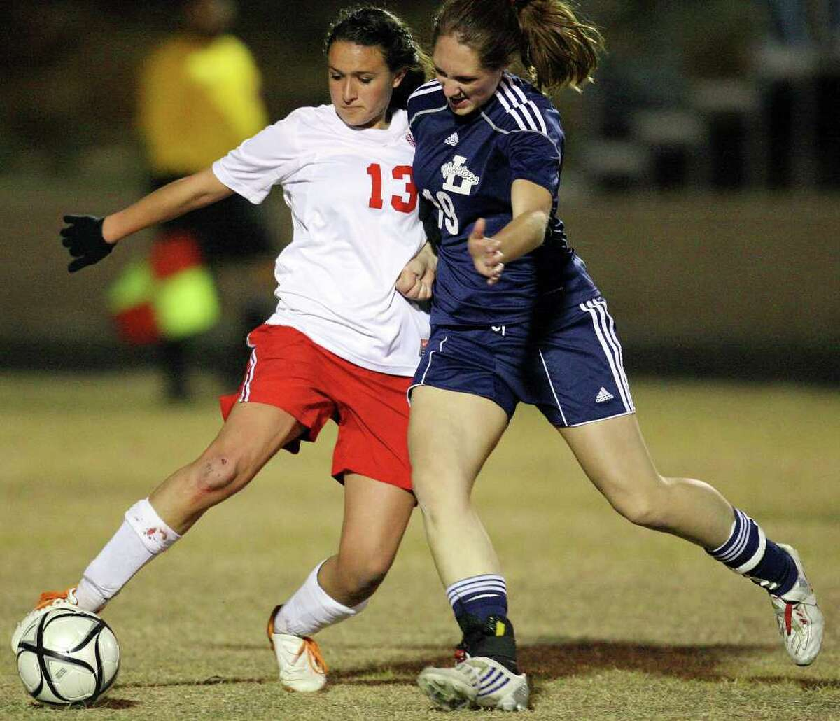 FOR SPORTS - Antonian's Sabrena Fennel (left) and Argyle Liberty Christian's Courtney Butler struggle for control of the ball Friday Feb. 11, 2011 at Antonian high school. Antonian won 2-1 in overtime. (PHOTO BY EDWARD A. ORNELAS/eaornelas@express-news.net)