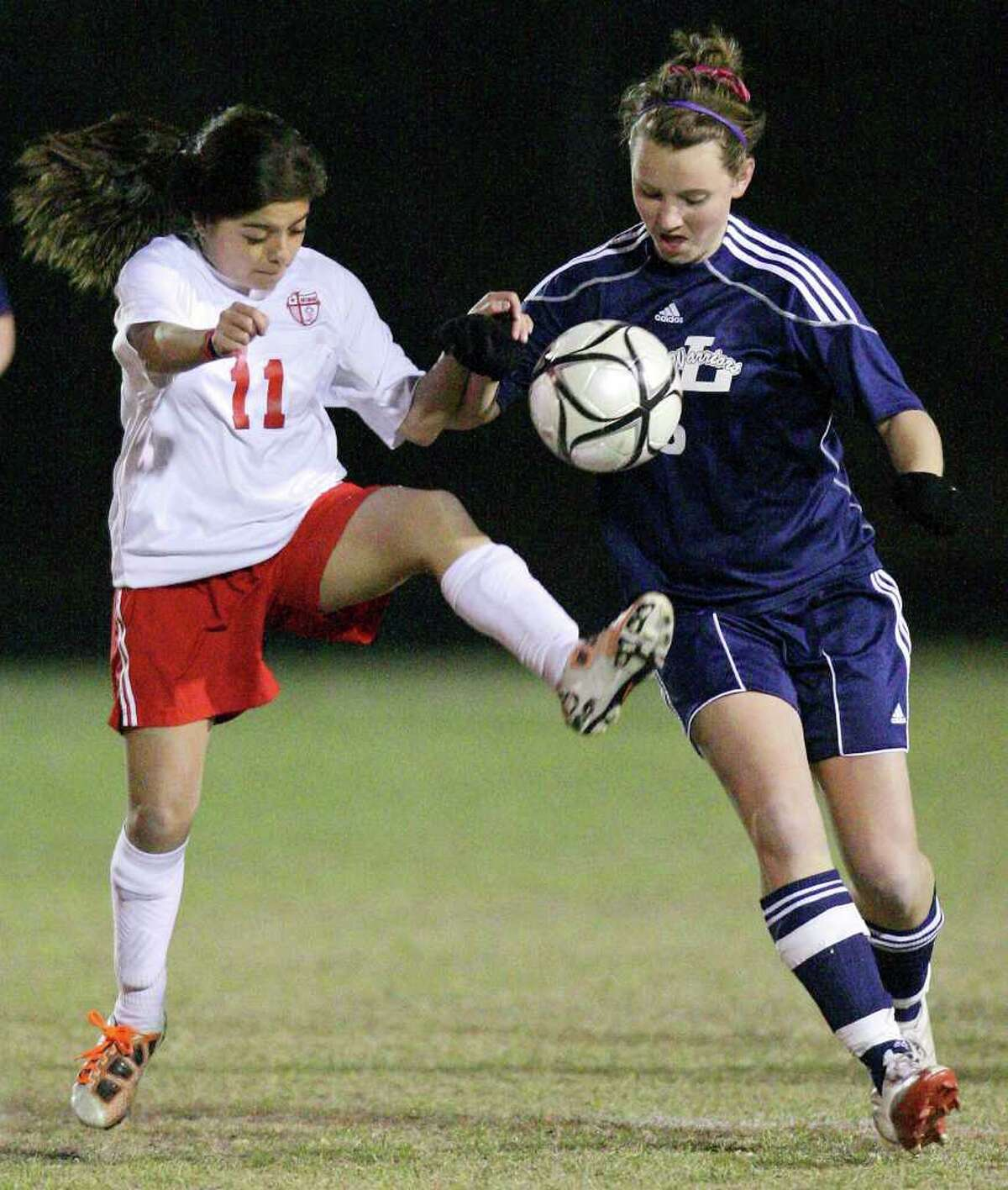 FOR SPORTS - Antonian's Pam Maldonado (left) and Argyle Liberty Christian's Lizzy Cook struggle for control of the ball Friday Feb. 11, 2011 at Antonian high school. Antonian won 2-1 in overtime. (PHOTO BY EDWARD A. ORNELAS/eaornelas@express-news.net)