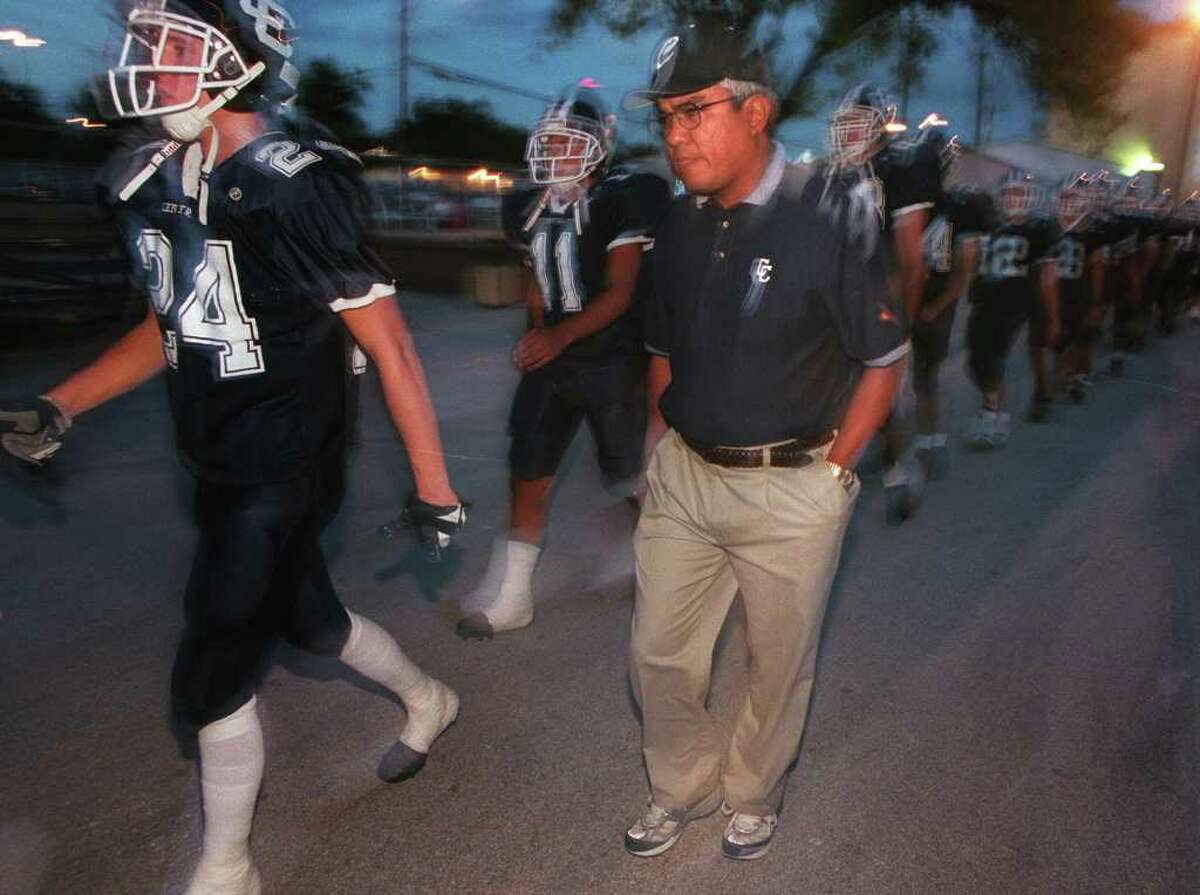 DAILY FOR SPORTS-- Central Catholic Head Coach Carlos Enrico marches to the field with his troops during a recent game at Central Catholic High School. Rick Hunter/Staff
