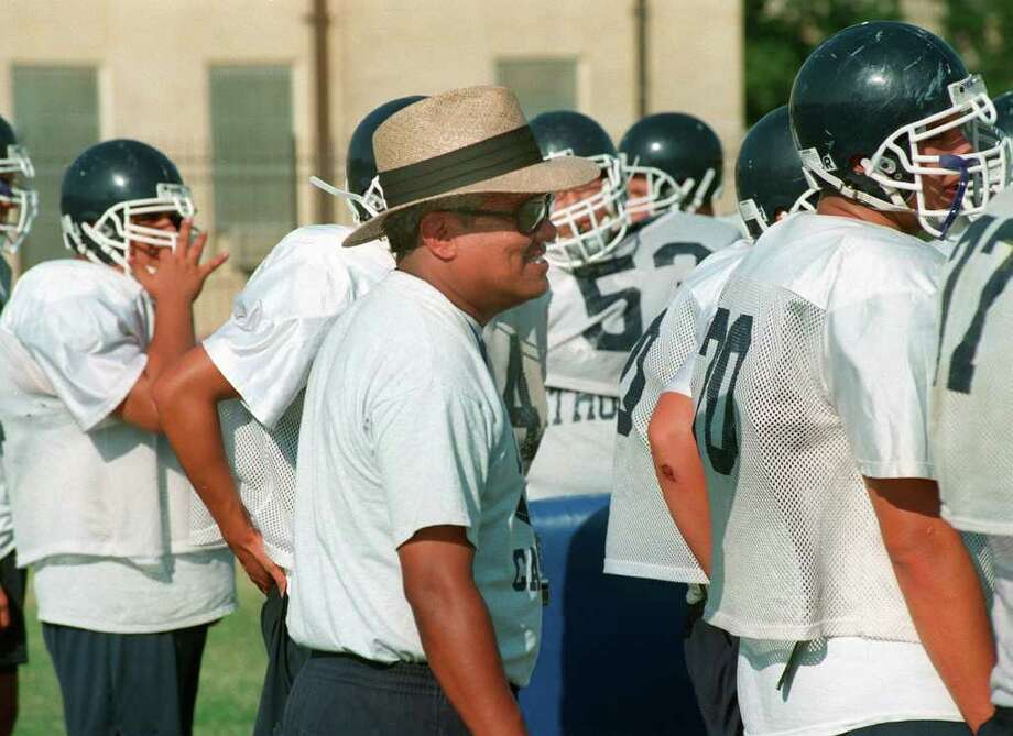 SPORTS FOOTBALL TAB CENTRAL CATHOLIC H.S. COACH CARLOS ENRICO: Carlos Enrico, coach of the Central High School Buttons during practice Monday, August 16, 1999 in San Antonio, TX.   Photo by Robert McLeroy/Staff. Shot on Film. 8/16/99. File 992959.