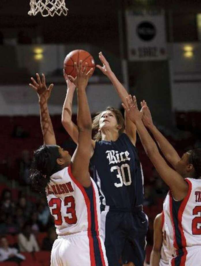 Rice's Jessica Kuster (30) drives strong to the basket between Houston's Lesslee Mason (33) and Courtney Taylor, right, during the second half of an NCAA college basketball game Thursday, Feb. 10, 2011 at Hofheinz Pavillion. Houston won 71-51. Photo: Bob Levey/Houston Chronicle Freelance