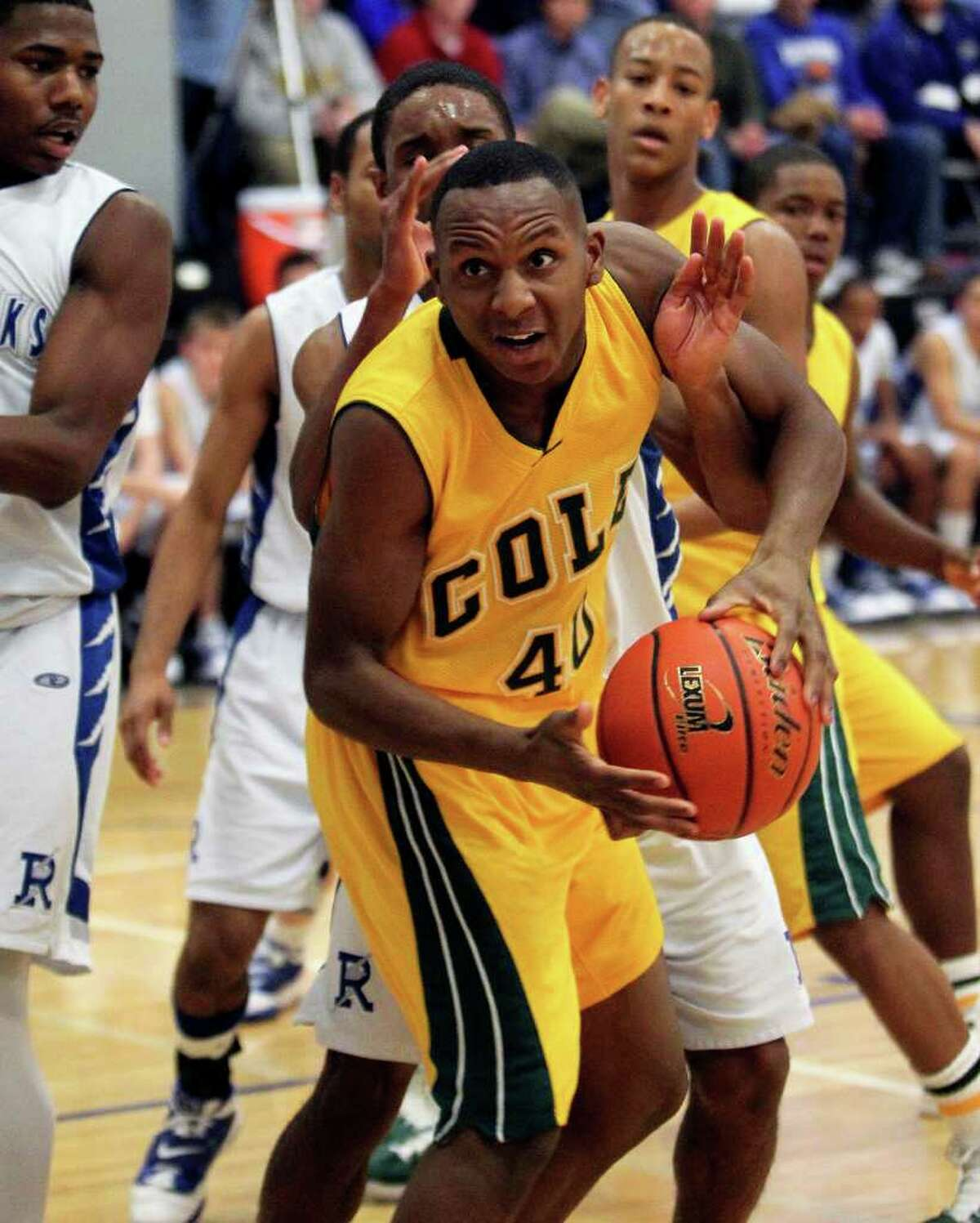 SPORTS Cole forward Kendrick Taylor (40) goes up against tight defense in the lane as Randolph hosts Cole at Randolph gym in boys basketball on February 11, 2011. Tom Reel/Staff