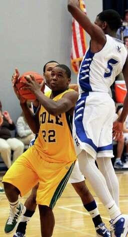 SPORTS   Cole guard Terrance Hodges (22) slips under the defense of Jacorian Duffield as Randolph hosts Cole at Randolph gym in boys basketball on February 11, 2011. Tom Reel/Staff Photo: TOM REEL, SAN ANTONIO EXPRESS-NEWS / © 2011 San Antonio Express-News