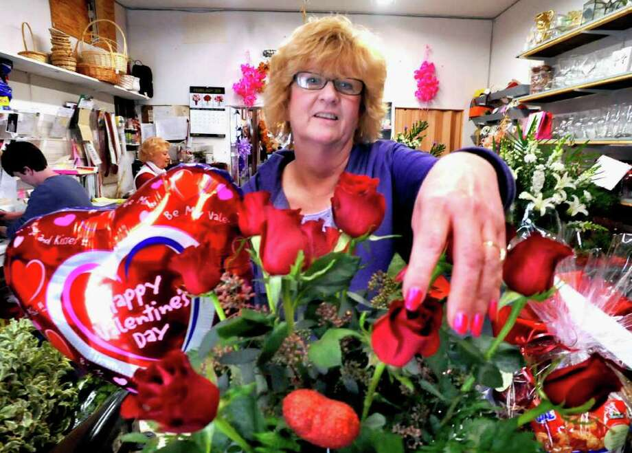 Jan Johnson arranges roses in a Valentine's Day bouquet at Forever Yours Flowers and Gifts in Danbury, Saturday, Feb. 12, 2011. Photo: Michael Duffy / The News-Times