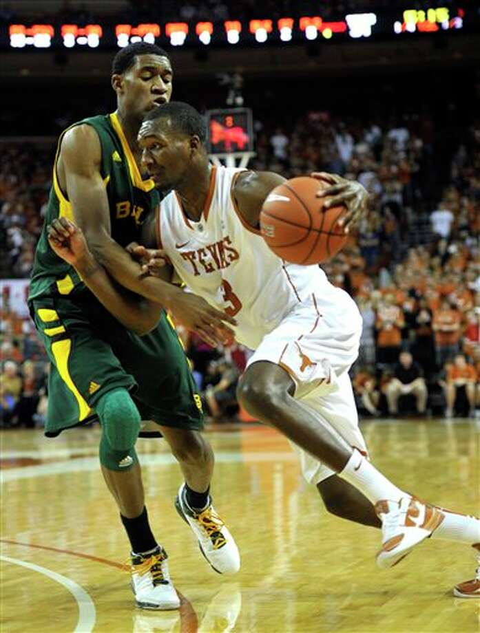 Texas forward Jordan Hamilton (right) drives around Baylor forward Perry Jones III on Saturday. Photo: Michael Thomas/Associated Press
