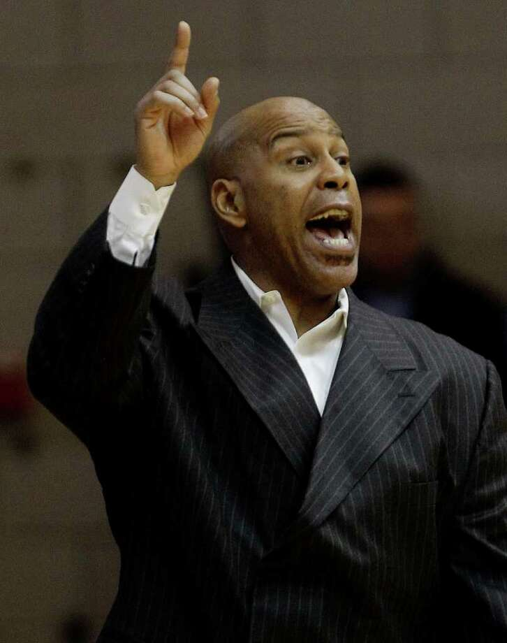 Providence head coach Phil Seymore shouts instruction to his team during the first half of an NCAA college basketball game against Connecticut at Alumni Hall on the Providence College campus in Providence, R.I., Saturday afternoon, Feb. 12, 2011. (AP Photo/Stephan Savoia) Photo: AP