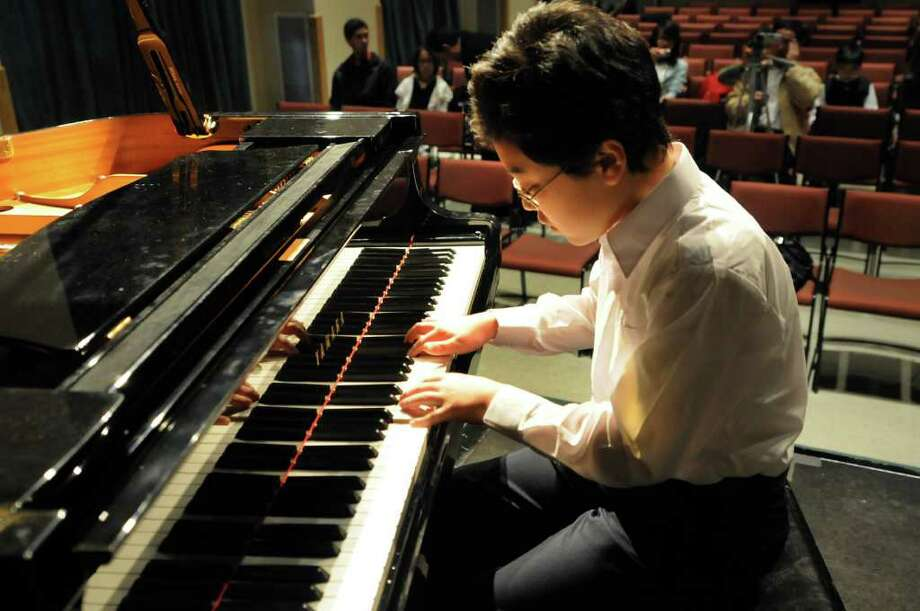 """Meyer Deokwu Nam, 11, rehearses the White Swan Scene from """"Swan Lake"""" before performing in the apprentice division during the second annual Tchaikovsky Piano Competition on Saturday at The Linda: WAMC's Performing Arts Studio in Albany. (Cindy Schultz / Times Union) Photo: Cindy Schultz"""