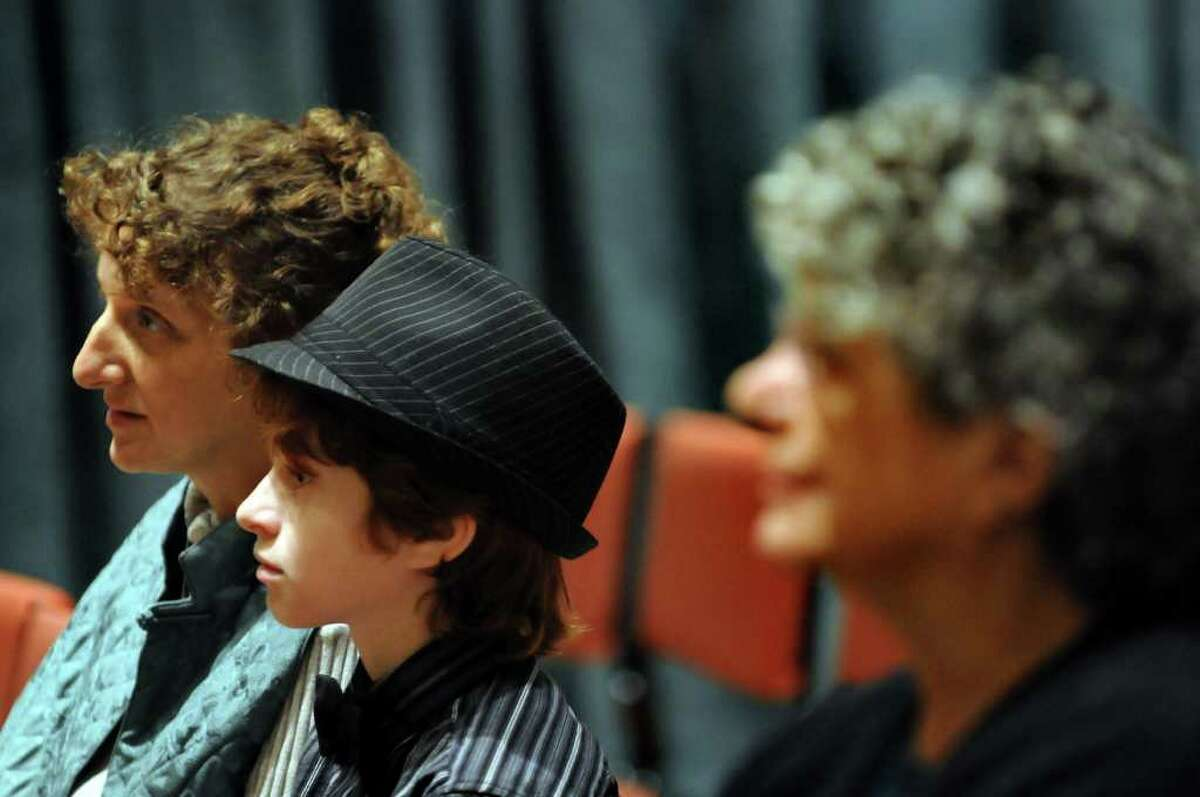 Julian Foy, 11, center, watches the other apprentice performers with his mother, Deyva Arthur, left, and grandmother Dorothy Arthur, during the second annual Tchaikovsky Piano Competition on Saturday at The Linda: WAMC's Performing Arts Studio in Albany. (Cindy Schultz / Times Union