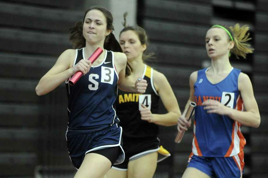 Courtney Mullen of Staples runs in the 4x800 relay during Saturday's Class LL track championship meet at the New Haven Athletic Center on February 12, 2011. Photo: Lindsay Niegelberg / Connecticut Post