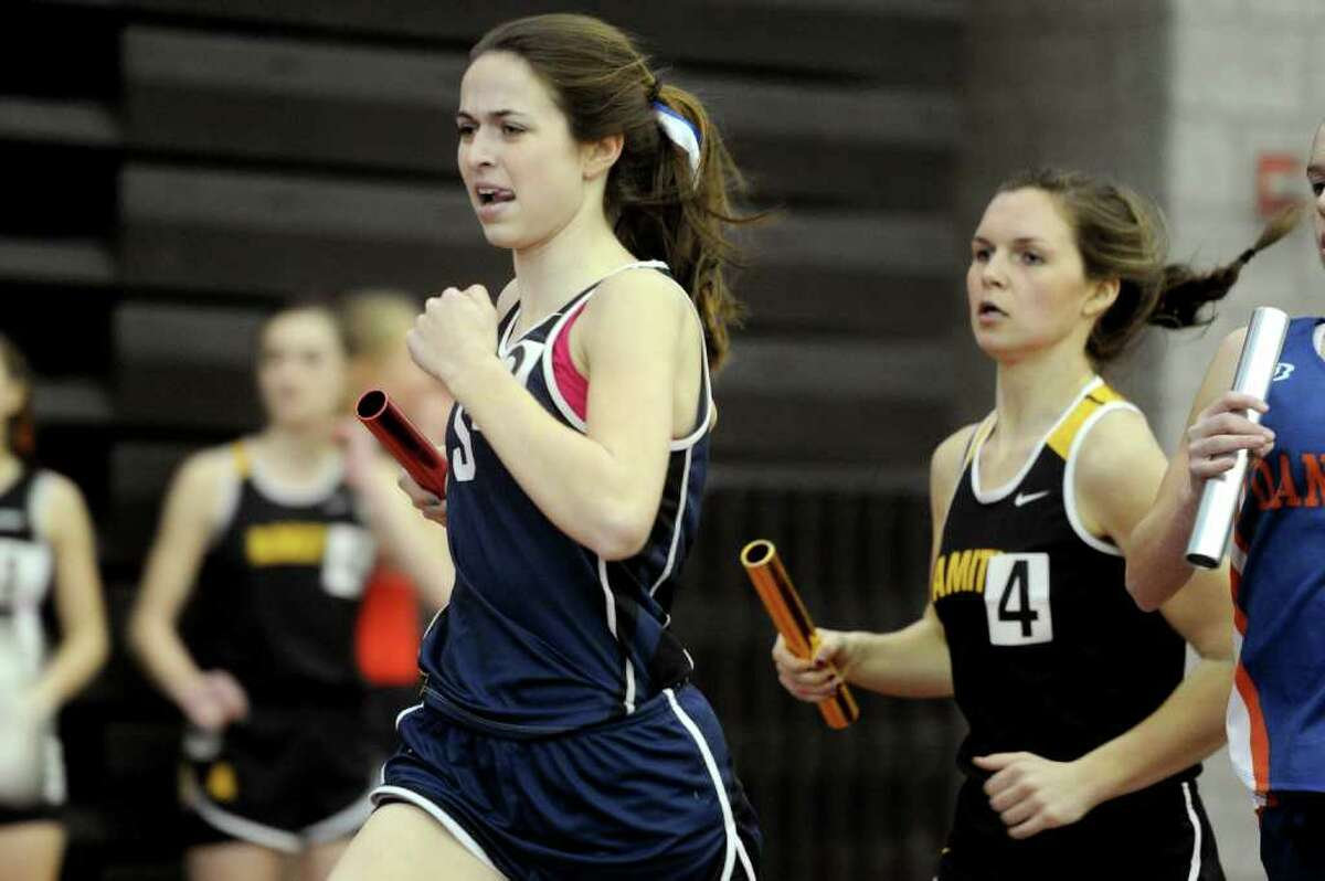 Courtney Mullen of Staples runs in the 4x800 relay during Saturday's Class LL track championship meet at the New Haven Athletic Center on February 12, 2011.