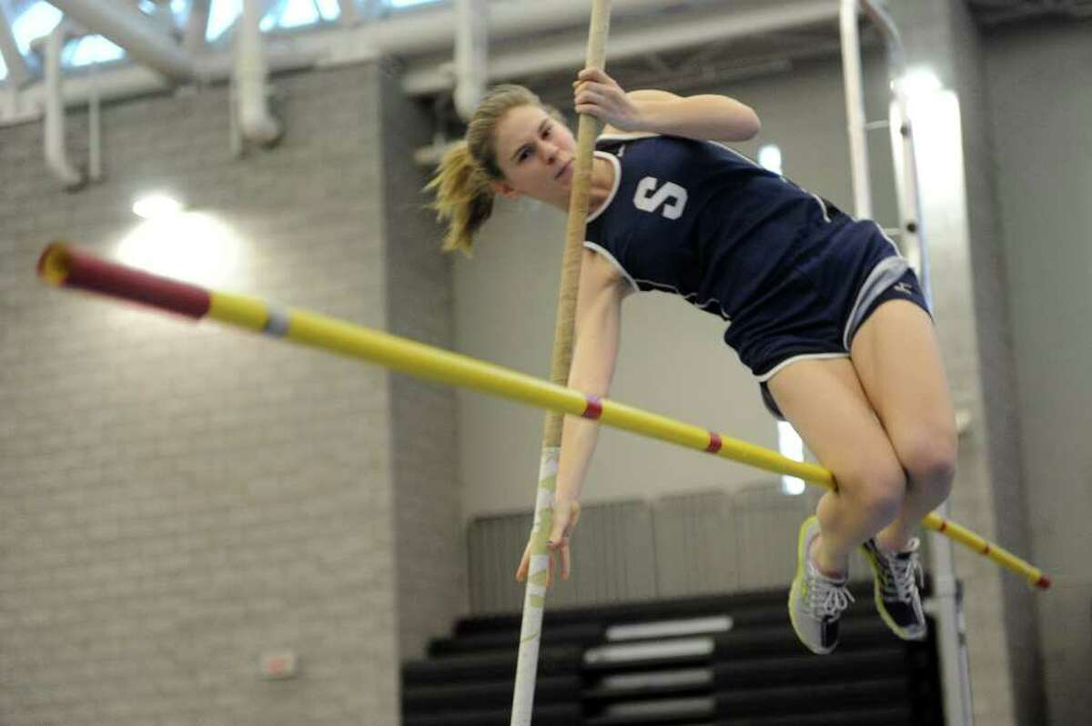 Staples' Sydney Friedman competes in the pole vault during Saturday's Class LL track championship meet at the New Haven Athletic Center on February 12, 2011.