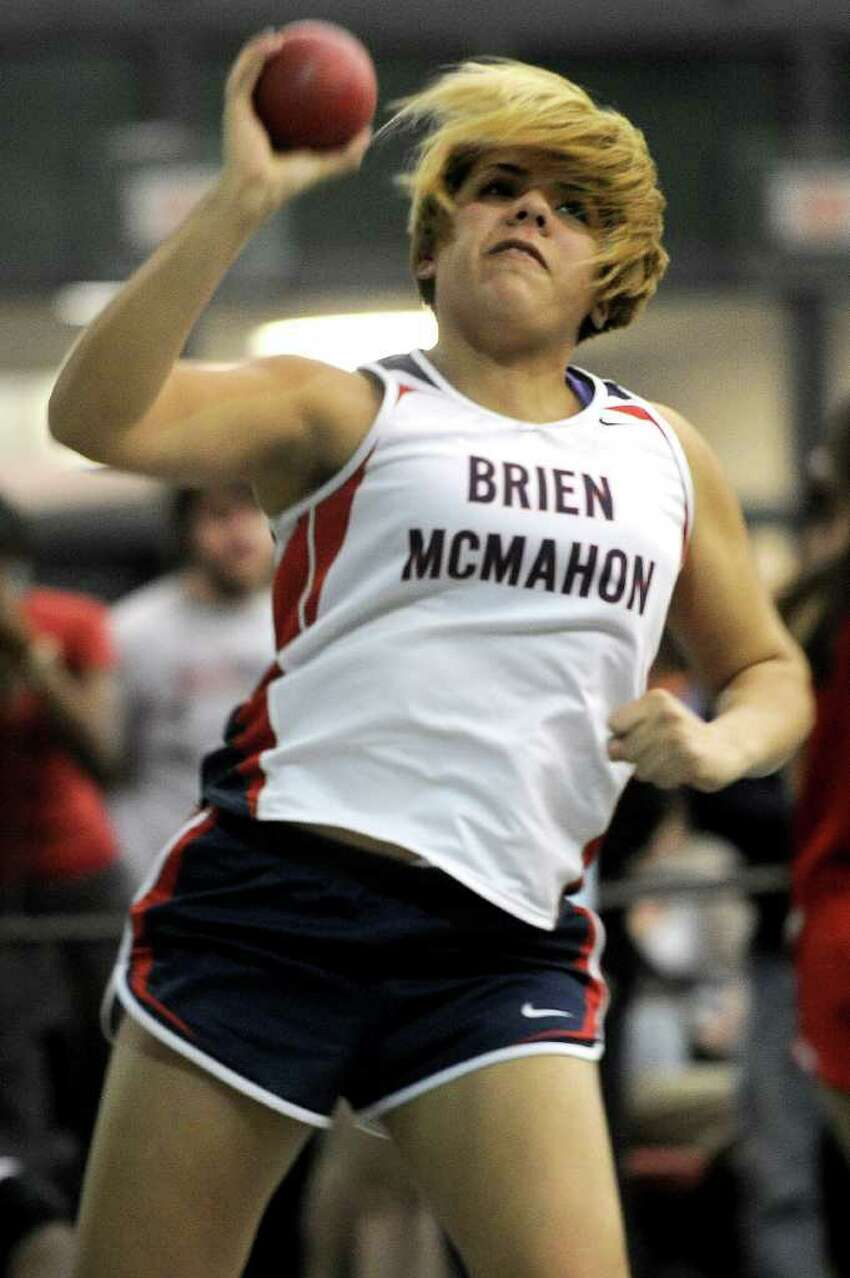 Brien McMahon's Kristin Medina competes in the shot-put during Saturday's Class LL track championship meet at the New Haven Athletic Center on February 12, 2011.