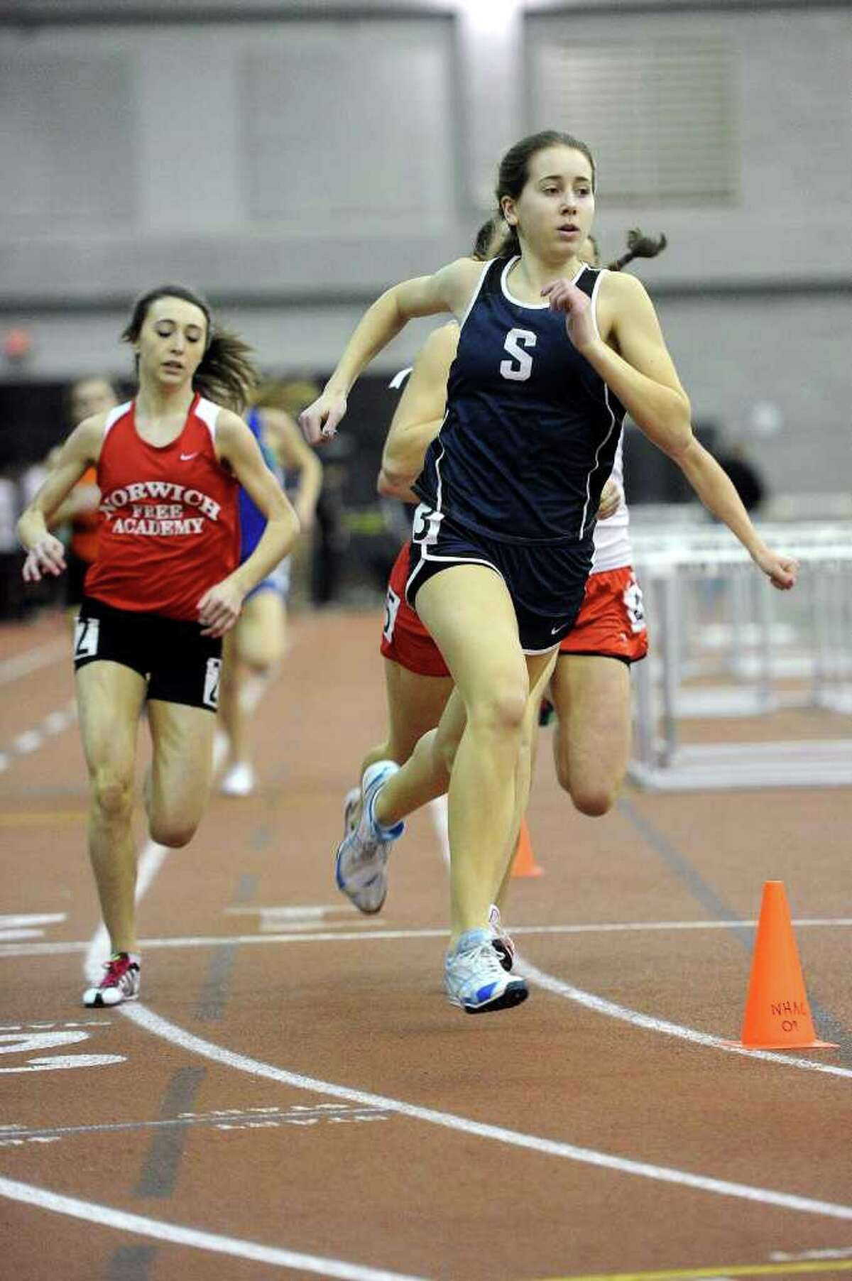 Staples' Ingrid Johnson competes during Saturday's Class LL track championship meet at the New Haven Athletic Center on February 12, 2011.