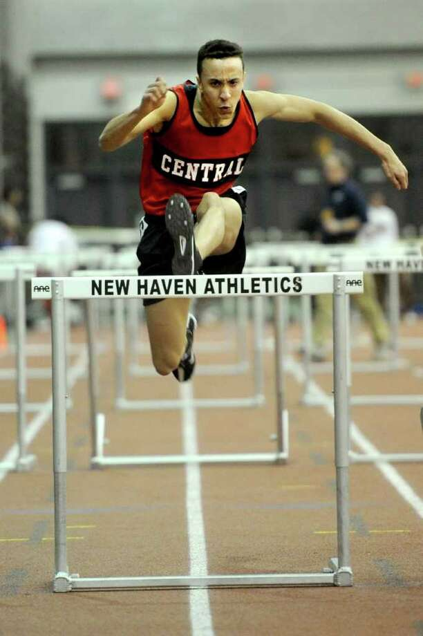Bridgeport Central's Nicholas Holodnak competes in the 55-meter hurdle finals during Saturday's Class LL track championship meet at the New Haven Athletic Center on February 12, 2011. Photo: Lindsay Niegelberg / Connecticut Post