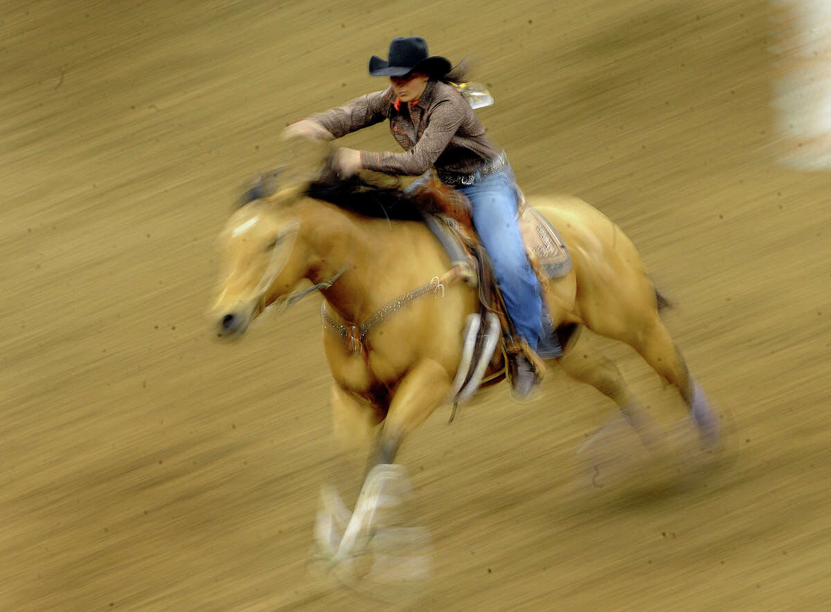 Savanah Reeves, a barrel racer from Cross Plains, Texas, rides to the best time of the matinee competition of the San Antonio Stock Show & Rodeo on Saturday, Feb. 12, 2011. Reeves' time was 14.17.