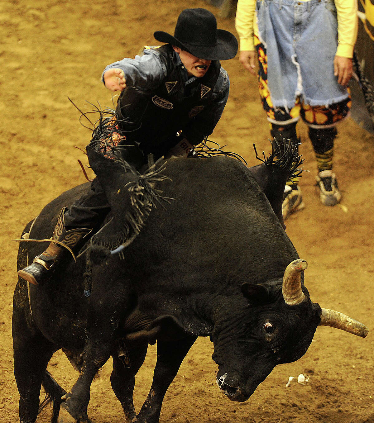 Jacob O'Mara from Prairieville, La., wins the bull riding competition by being the only cowboy stay on his bull for eight seconds during the matinee competition at the San Antonio Stock Show & Rodeo on Saturday, Feb. 12, 2011.