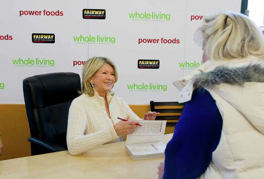 """Martha Stewart signs copies of her new book """"Power Foods"""" and her team of lifestyle experts present a day of demos on smart shopping, healthy eating and yoga at Fairway Market in Stamford, Conn. on Saturday February 12, 2011. Photo: Kathleen O'Rourke / Stamford Advocate"""