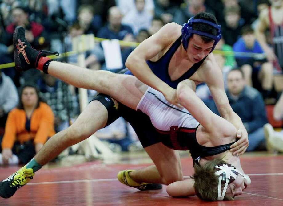 Nick Jimenez, of Westhill, takes on Jay Cummiskey, of Greenwich, in the 152 class of the FCIAC wrestling championship at New Canaan High School in New Canaan, Conn. on Saturday February 12, 2011. Jimenez won the match. Photo: Kathleen O'Rourke / Stamford Advocate