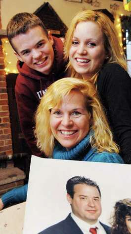 Hugh Kelleigh, 18, and his sister Courtney, 20, along with their mother, Desiree, run their family restaurant, The Good Times Restaurant in Ballston Lake for years. The elder Hugh Kelliegh has multiple sclerosis and early onset Alzheimer's disease. He is seen in a family keepsake photo in the foreground.  (Luanne M. Ferris / Times Union) Photo: Luanne M. Ferris