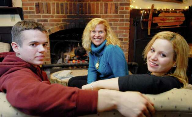 The Kelleigh family, Hugh, 18, and Courtney, 20, gather with their mother Desiree.  (Luanne Ferris / Times Union) Photo: Luanne M. Ferris
