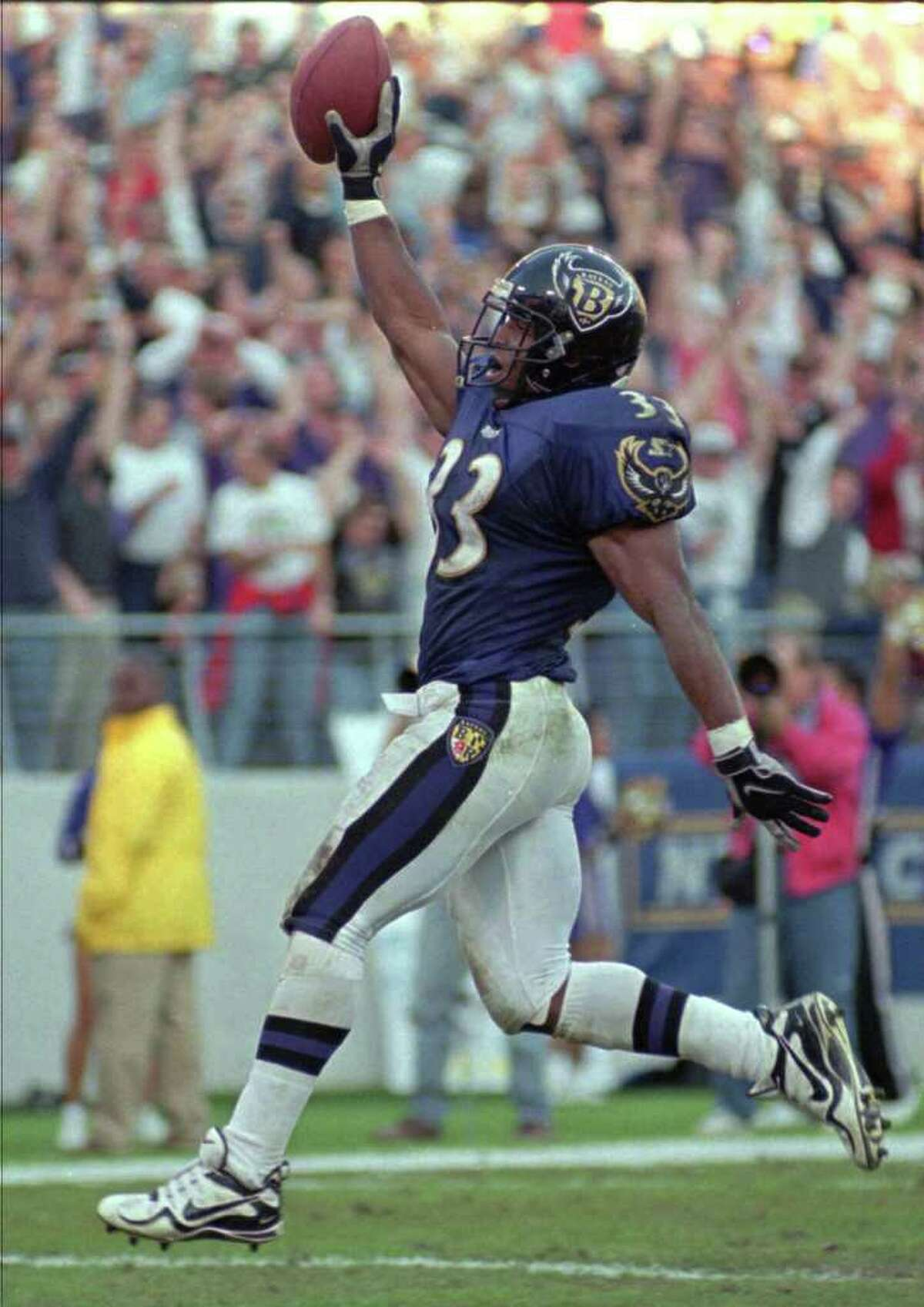 Baltimore Ravens running back Priest Holmes celebrates his touchdown run in the fourth quarter against the Indianapolis Colts Sunday, Nov. 29, 1998. the Ravens won 38-31. (AP Photo/Nick Wass)